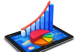 Bar graph and pie chart on an tablet show business growth from technology marketing.