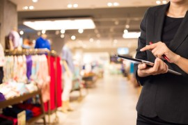 Woman solving retail problems taking inventory on mobile pos