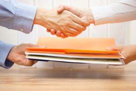 Handshake as vendor passes POS leads reseller